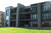 100207816, Riverfront apartment in secure golf estate