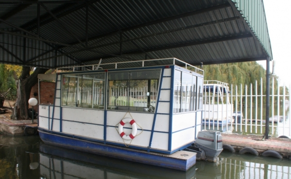 boat-house-on-river